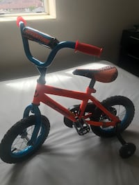 toddler's orange and black bicycle with training wheels Mississauga, L4Z