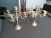 two gold-colored candle holders