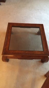 brown wooden framed glass top coffee table 896 mi