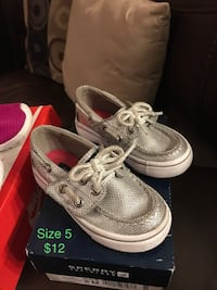 pair of gray leather boat shoes with blue box