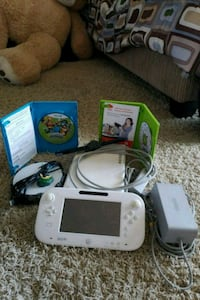 white Nintendo Wii with controllers and game  Mililani, 96789