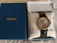 Round Gold Seiko Kinerik watch with leather bra