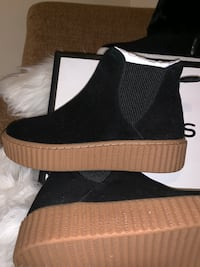 New, never used, J Slides women boots Black suede. Without the original box Guttenberg, 07093