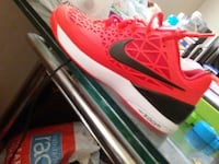 unpaired red and black Nike Zoom basketball shoe Baltimore, 21212