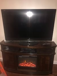 Tv stand with fire place & 55 inch Flat screen  328 mi