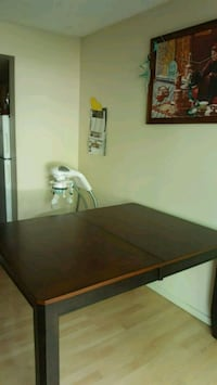 rectangular brown wooden table with chairs Edmonton, T5T 1P8