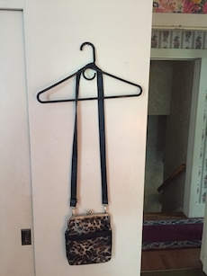 brown and white leopard pattern cross body bag