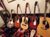 Used acoustic guitars and one signed by poison lea Perham, 56573