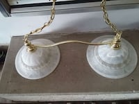white and gold-colored pendant lamp