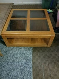 brown wooden framed glass top coffee table Merced