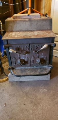 FISHER LARGE WOOD STOVE WITH INSULATED PIPING Windsor, N8T 1W9