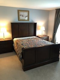 brown wooden bed frame with mattress headboard and end tables Columbia, 21044