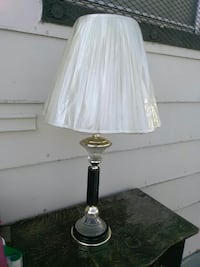 black and gray base with white lampshade table lam