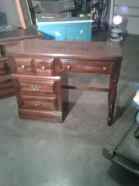 brown wooden single pedestal desk Hagerstown