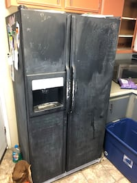 black side-by-side refrigerator with dispenser 2378 mi