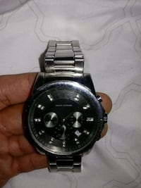 round black chronograph watch with silver link bracelet Gaithersburg, 20878
