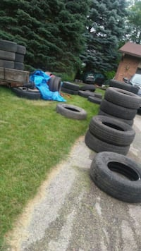 Tires along curb. 6307 Johnson street McFarland, 53558