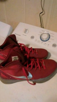 pair of red Air Jordan basketball shoes