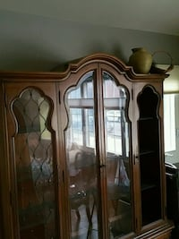 brown wooden framed glass display cabinet Brooklyn, 11236