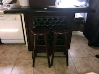 two brown wooden bar stools Commerce City, 80022