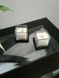 2 square candles with square wooden coasters