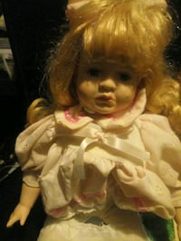 Porcelin doll with stand