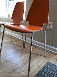 two orange leather padded chairs Arlington, 22206