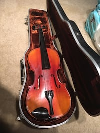 brown violin in case in case