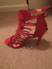 pair of red open-toe strappy heeled sandals ATLANTA
