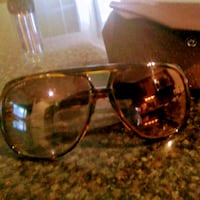 Brown Gucci sunglasses with case good condition Laurel, 20723
