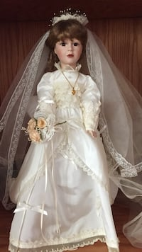 "22"" bride doll. ivory dress with stand. Mint condition."