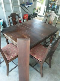 rectangular brown wooden table with four chairs dining set New Iberia, 70563