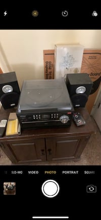 Stereo with speakers cassette  radio turntable  and cd