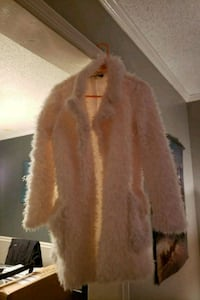 Cream colored coat beautiful size small true to si Huntsville, 35803