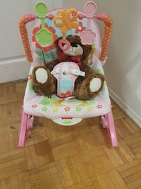 baby's pink and green floral Fisher Price bouncer