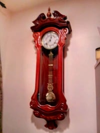 Solid redwood, wall pendulum clock. Accurate to 2 min in 6 mos.beauty! Livonia, 48154
