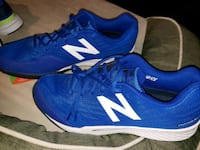 pair of blue New Balance running shoes with box 2239 mi