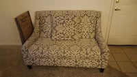 beige and gray fabric floral futon