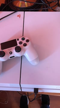 white Sony PS4 game controller