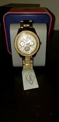 round silver chronograph watch with gold link bracelet Mississauga, L4Z 3J2