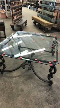 Metal table with glass top. The red stickers can be peeled off. Just serves as protection for the glass. 46 x 46 inches. Pomona, 91766