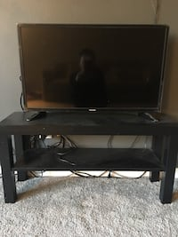 black flat screen TV with black wooden TV stand Lone Tree, 80124