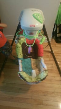 baby's white and green Fisher-Price cradle Montréal, H1G 4Y4