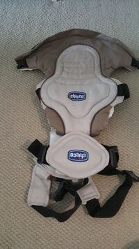 white and brown Chicco baby carrier