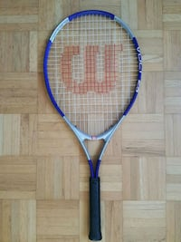 blue and black Wilson tennis racket