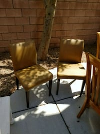 two brown wooden framed brown leather padded chair Las Vegas, 89183