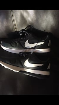 pair of black-and-white Nike shoes