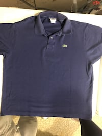 Navy Blue Lacoste Polo size 7 (XL)