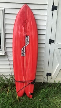 Red and white coca-cola surfboard