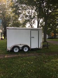 white and black enclosed trailer Burdett, 14818
